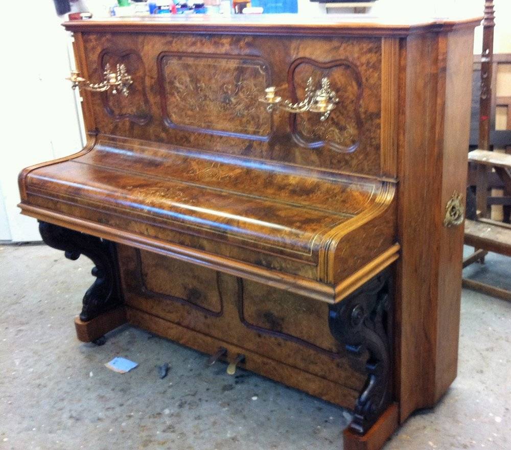 Musical Instrument Restoration: Upright walnut piano, veneer repairs done, gilded details restored and french-polished.
