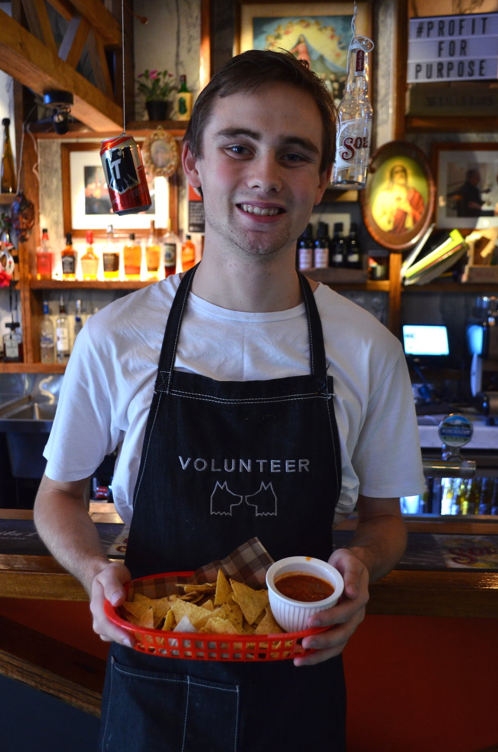 Justin Shaw, serving at the The Two Wolves Community Cantina