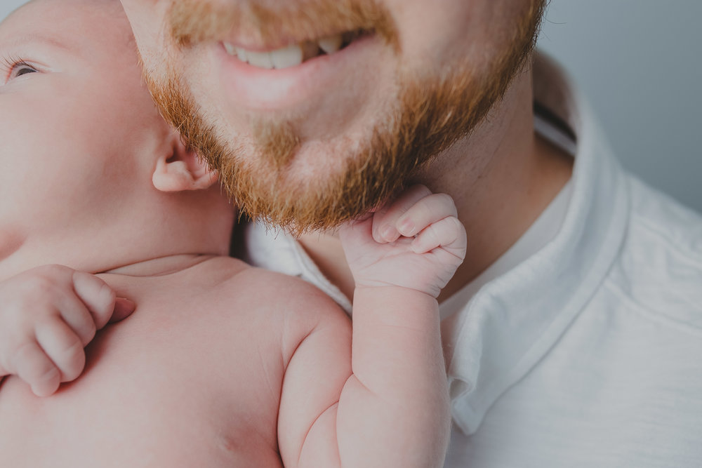 Baby grabs daddys beard