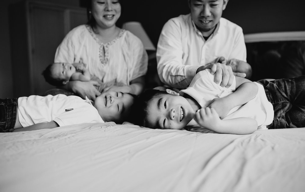 Black and White Newborn Family Bedroom Photo