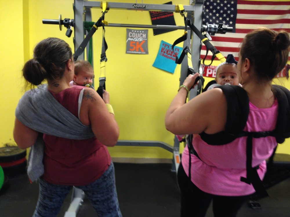 Two of our moms working out with their little ones!