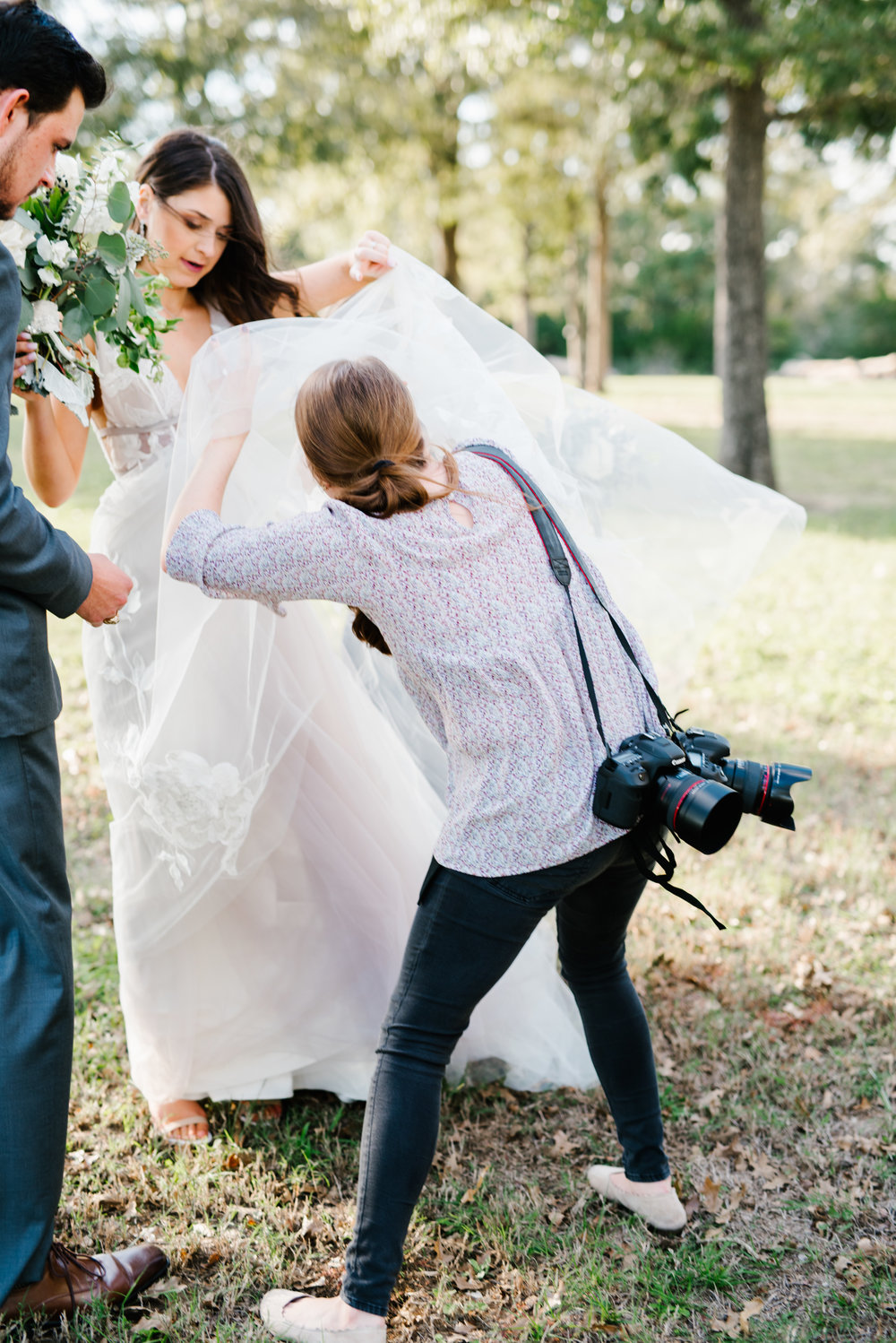 This is what it looks like when a bug gets in my bride's tulle. I do this so often! LOL