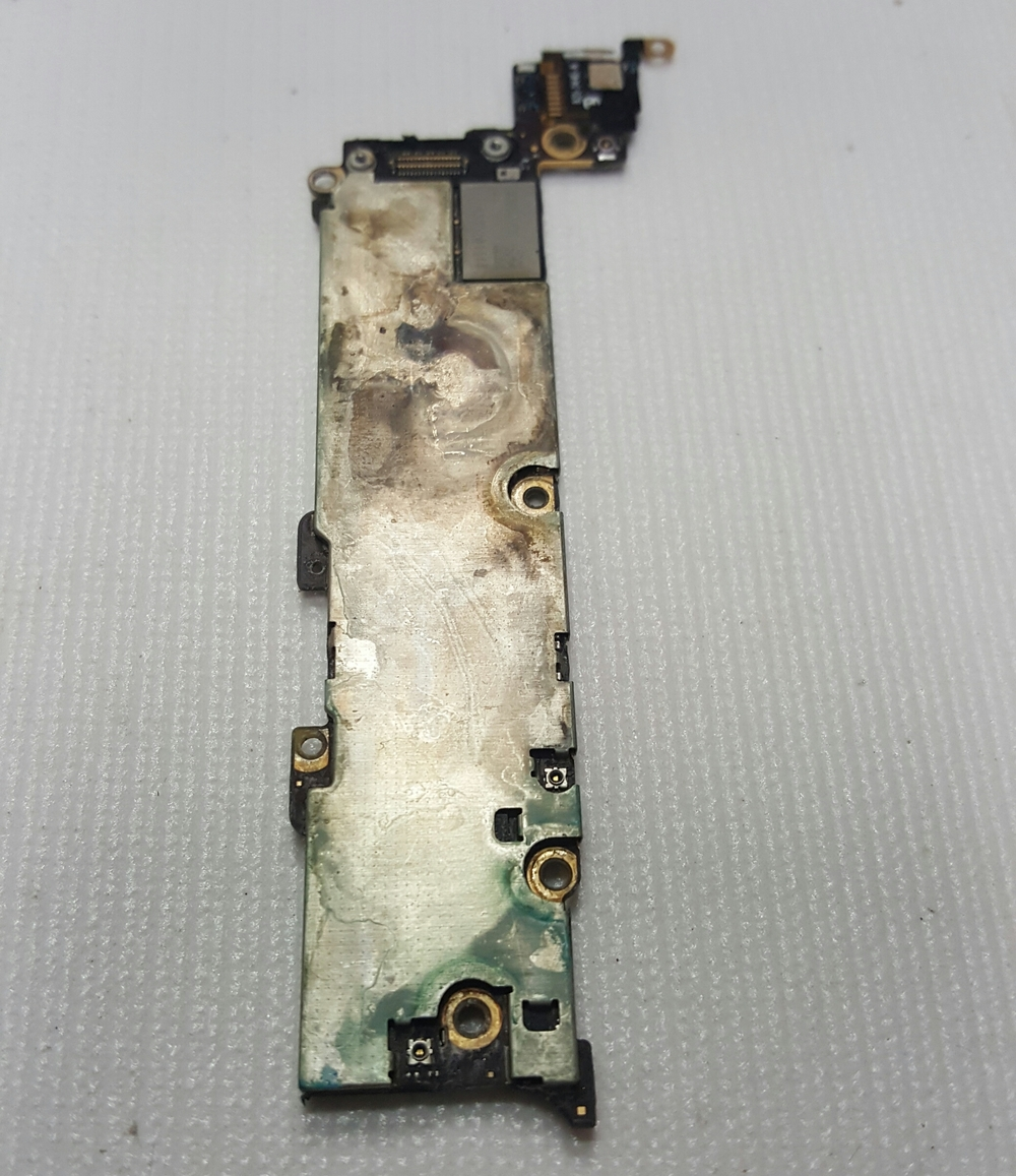 A logic board showing signs of oxidation
