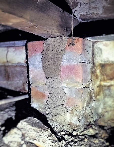 A termite tunnel into hardwood flooring.
