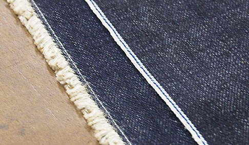 Shuttle Loom Selvedge atop Modern Loom Selvedge