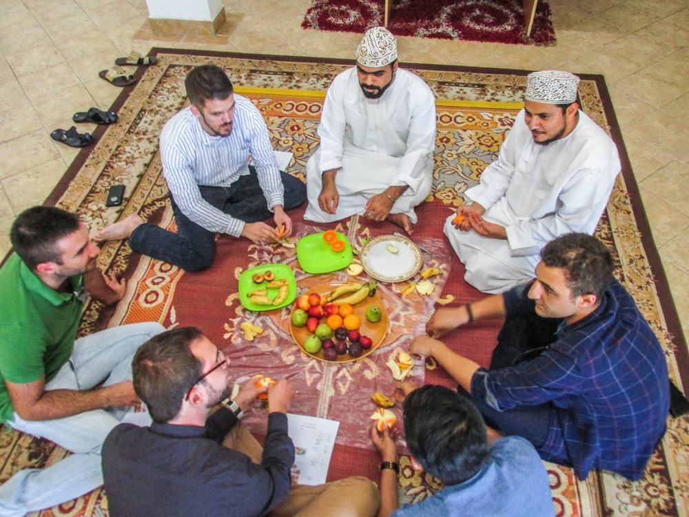 Students learn how to enjoy coffee the Omani way – fruit, dates, and coffee – and speaking Arabic of course! (Photo: CJ Aragon)