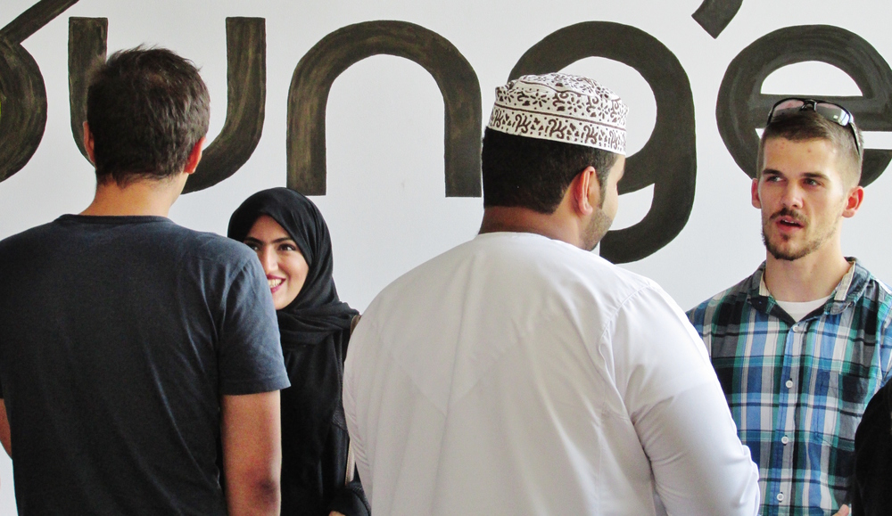 Study abroad students speak Arabic with their Omani peers in Muscat (Photo: CJ Aragon)