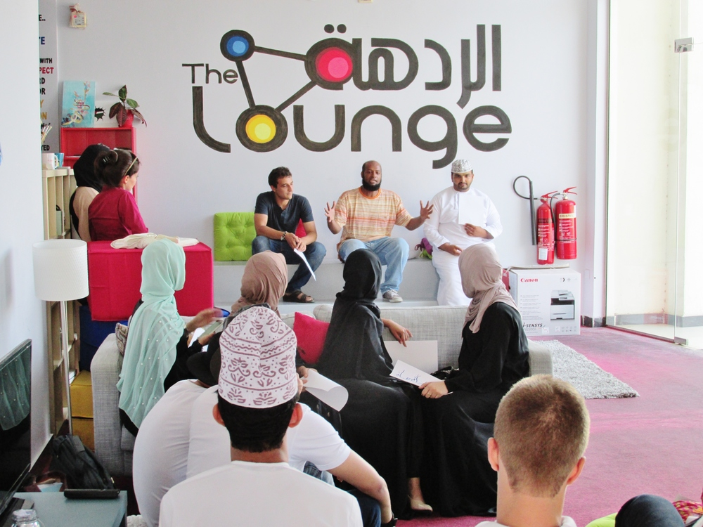 Students attend an event to practice their Arabic at a meeting place in Muscat