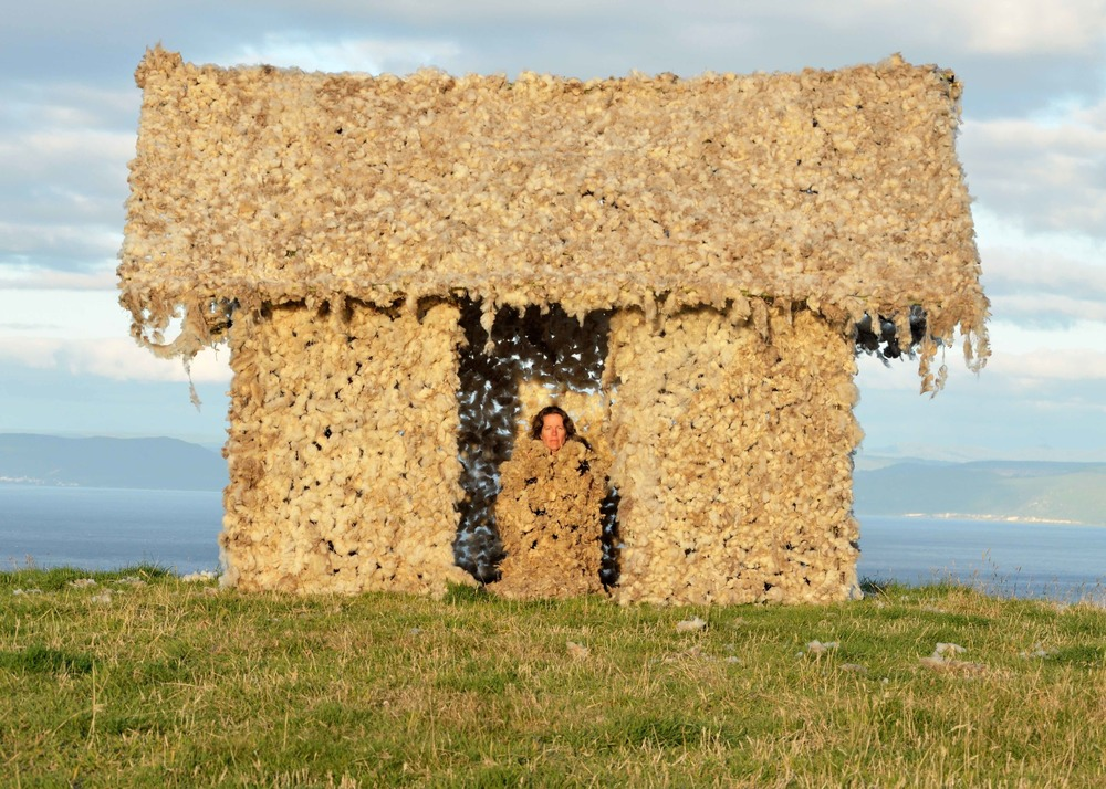 Artist Nancy Winship Milliken in  Tika Whare , an installation made in New Zealand with thousands of sheep surrounding in the pasture.