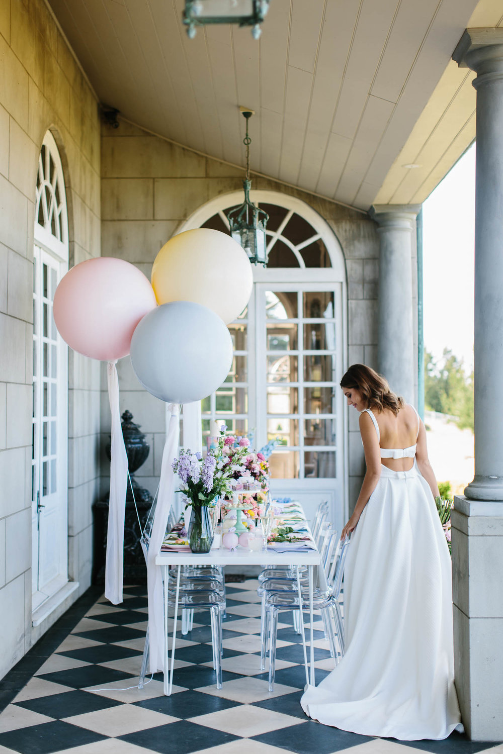 Bride in a Backless Wedding Dress with Pastel Balloons | Wedding Photography by Kas Richards