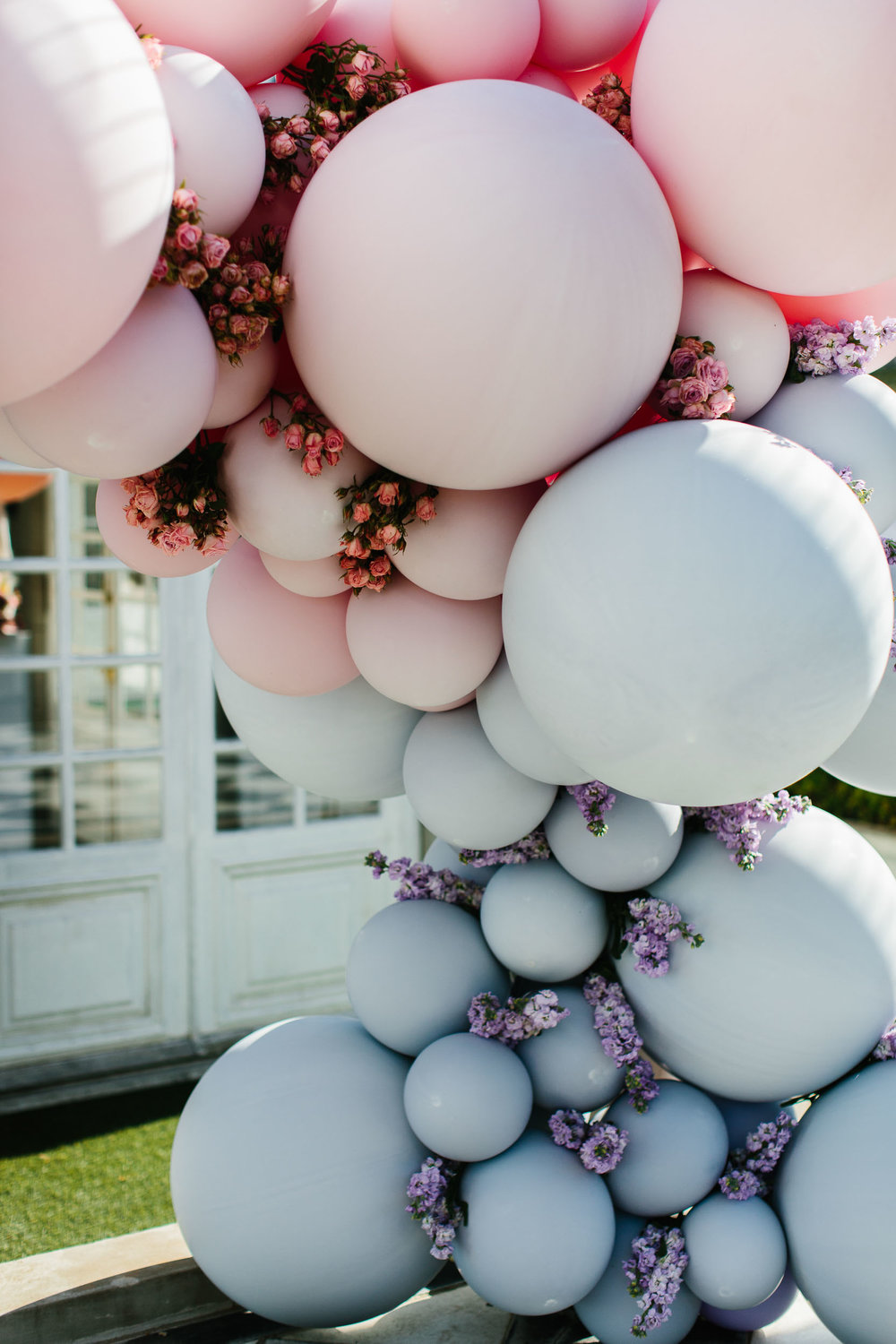 Luxe Balloon Arch with Flowers | Wedding Photography by Kas Richards