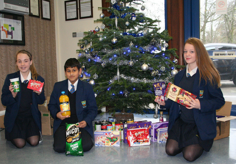Students with some of the items donated