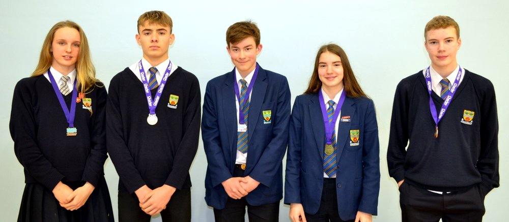 From left to Right: Lizzie, Isaac, David, Piper and Connor    David - Bronze in Freestyle                 Cameron - Bronze in Breast stroke        Piper – Gold in Breast stroke         Isaac  – Gold in Breast stroke            Connor – Silver in Butterfly       Lizzie  – Gold in Back stroke