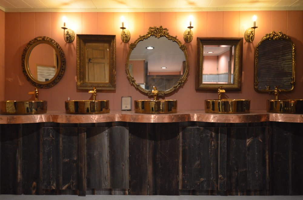 5 brass bathrooms sinks for the women's bathroom in the barn
