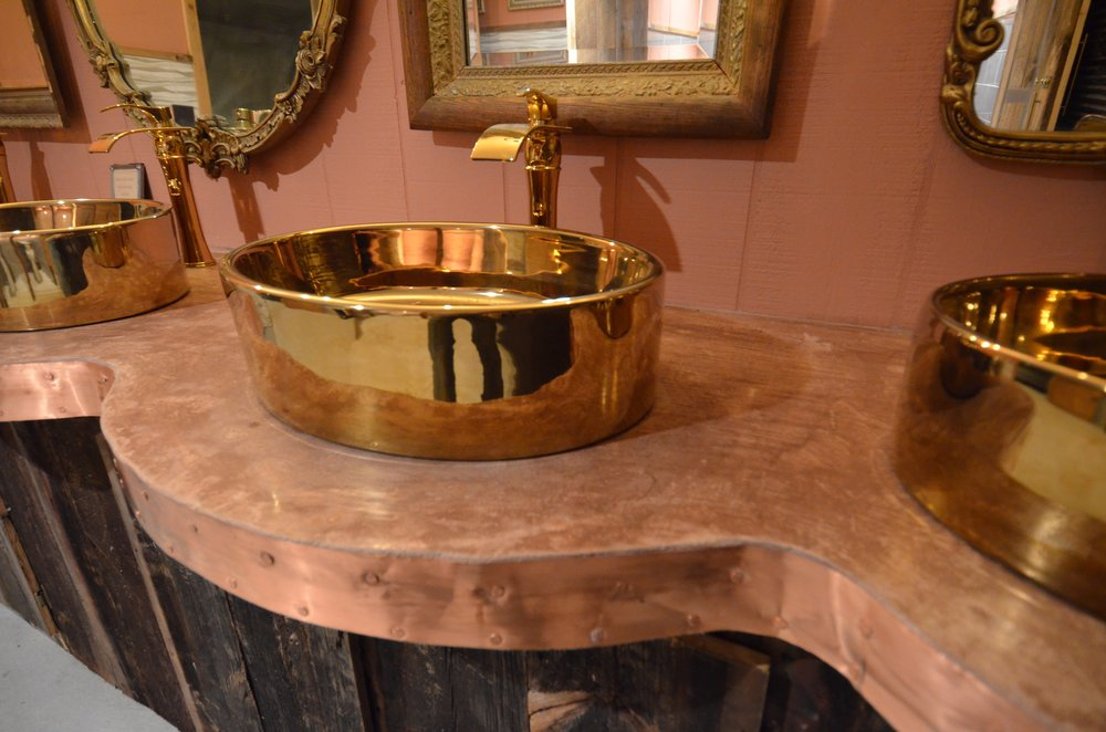 Beautifully appointed antique sinks in the barn