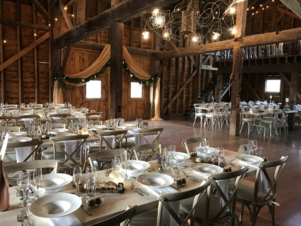 All handmade tables, white washed cross-back chairs, china and silverware is owned by the farm and included