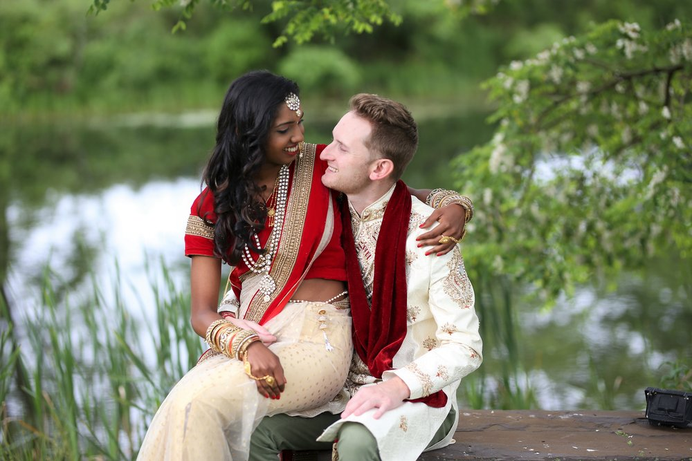 Indian bride and Irish groom by the lake