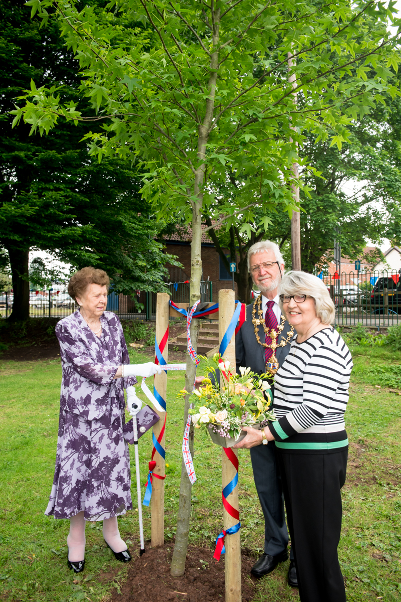 Mrs Vickers dedicating a tree for Her Majesty alongside Town Mayor Chris Munslow and Town Councillor Sue White.