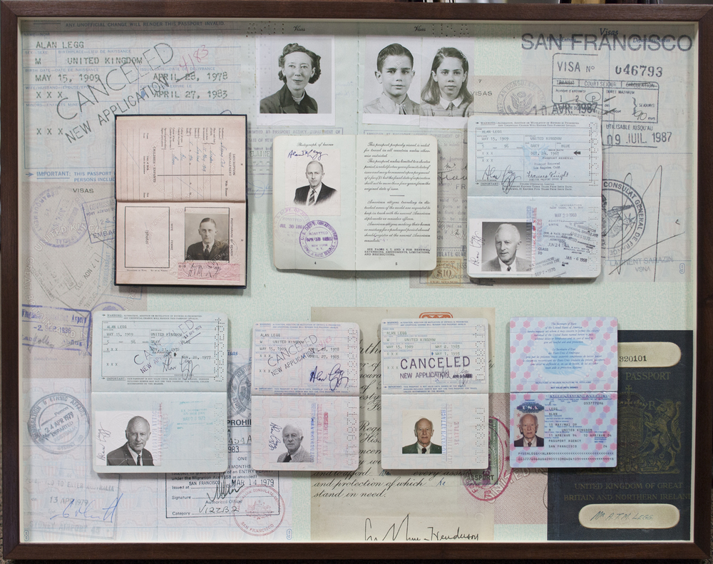shadowbox of client's many passports. All graphics done in-house.