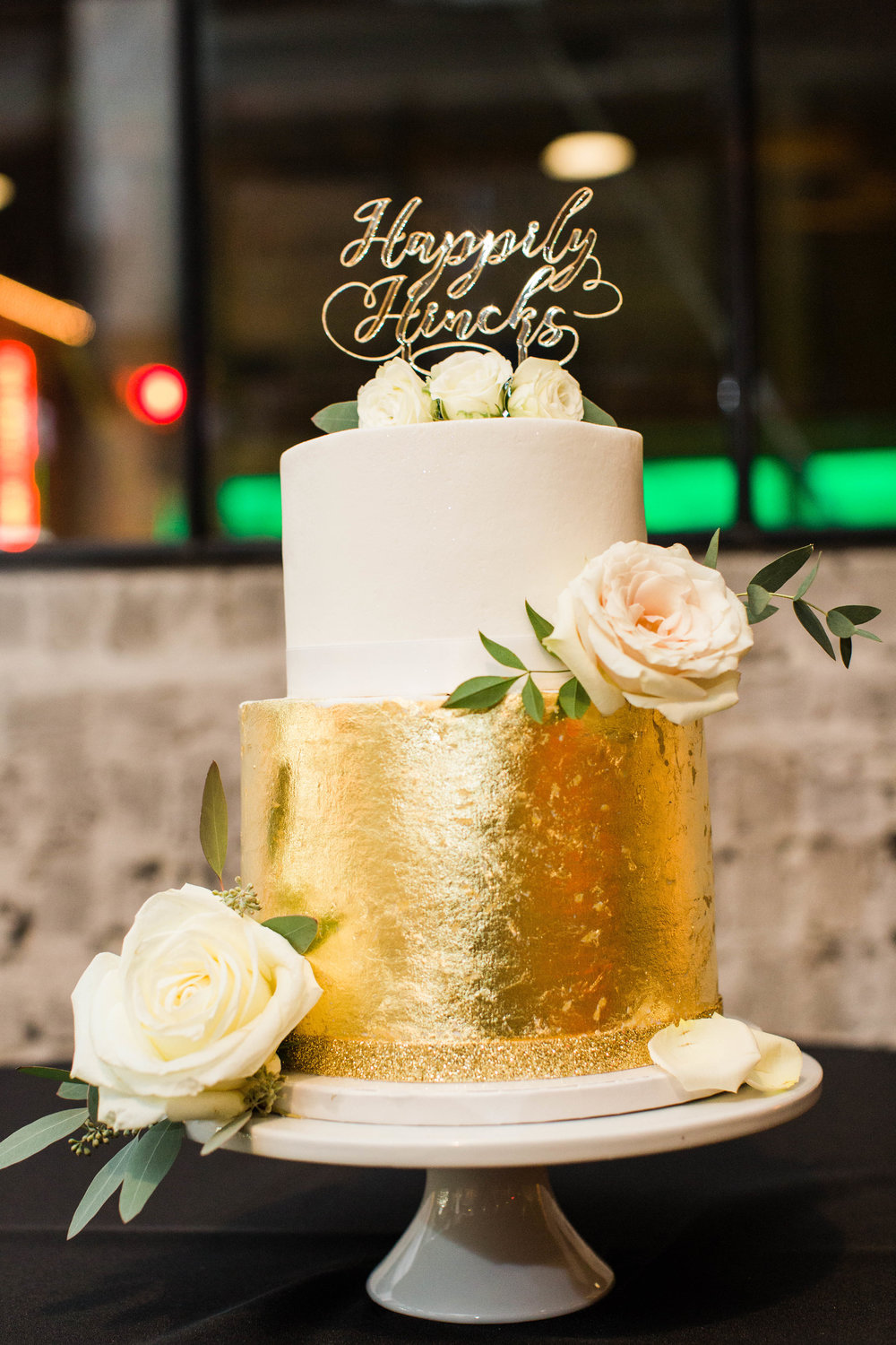 Photo cred:  Marie Violet  // Cake by  Cake Delights  // Topper by  Jollity & Co . // Flowers by  Studio Posy