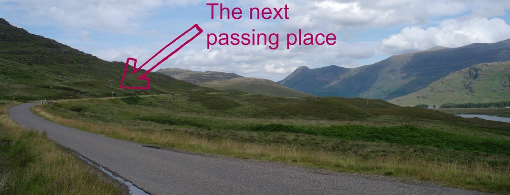 The A896, between Shieldaig and Lochcarron in Wester Ross. Single-track hereabouts…feeling here of the back-of-beyond…sorry, I mean 'unspoilt wilderness'. And doesn't that next 'passing place' sign look a long way off?