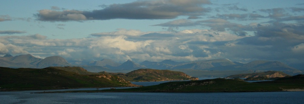 Evening clouds forming over the peaks of the Fisherfield / Letterewe area, viewed from Laide of Reiff in the North-West Highlands.