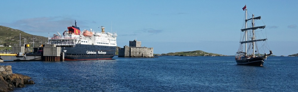 Barra Ferry (left) in Castlebay. Kisimul Castle behind it.