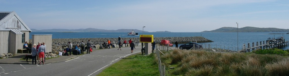 Eriskay ferry approaching Barra and the ferry pier.