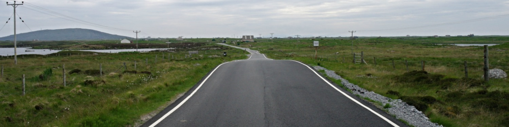 Ah, that's better. Not a car in sight. Actually, not a thing in sight really. And a road uncertain if it's single track or narrow two-lane. Driving in Scotland – South Uist, Outer Hebrides.