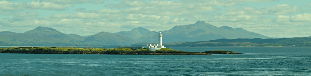 Lismore Lighthouse with Ben Cruachan behind (right)