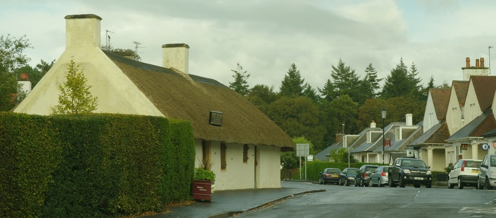 Burns Cottage, on the left, now slightly incongruous in suburbia.