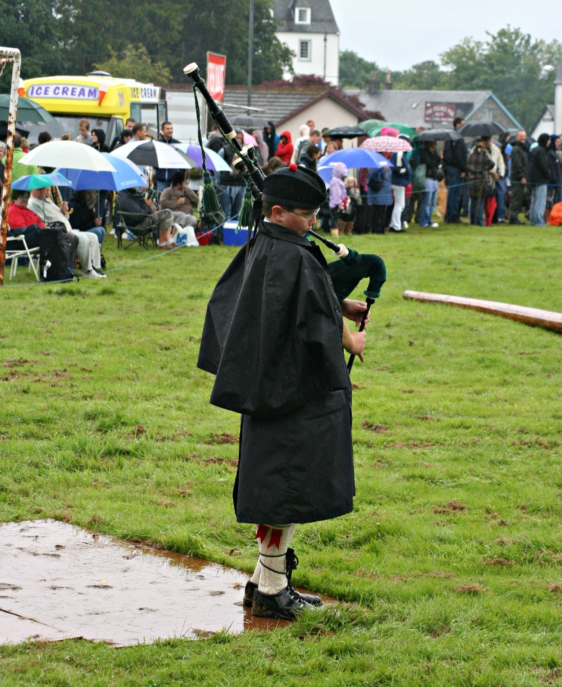 Piping in the rain at Killin Highland Games