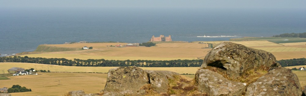 Tantallon Castle, distantly, on the coast, centre, from the top of the Berwick Law