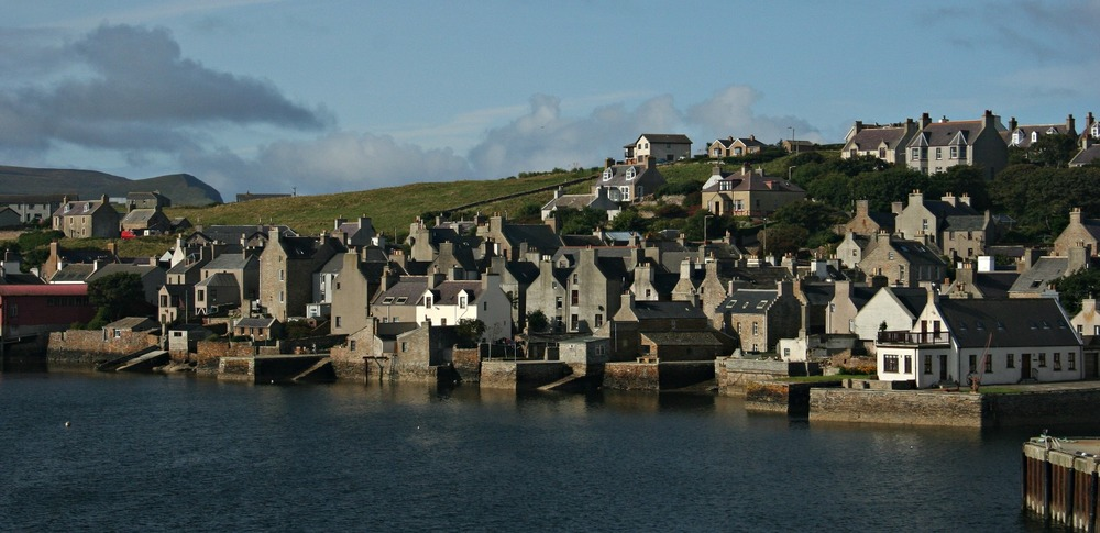 Stromness as the ferry approaches. Island of Hoy distant, far left.