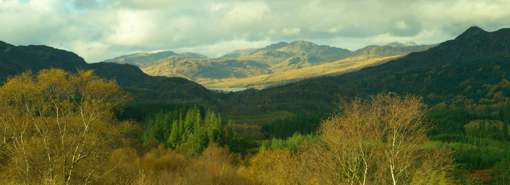 Looking towards distant Loch Katrine. Ben An in shadow, right.