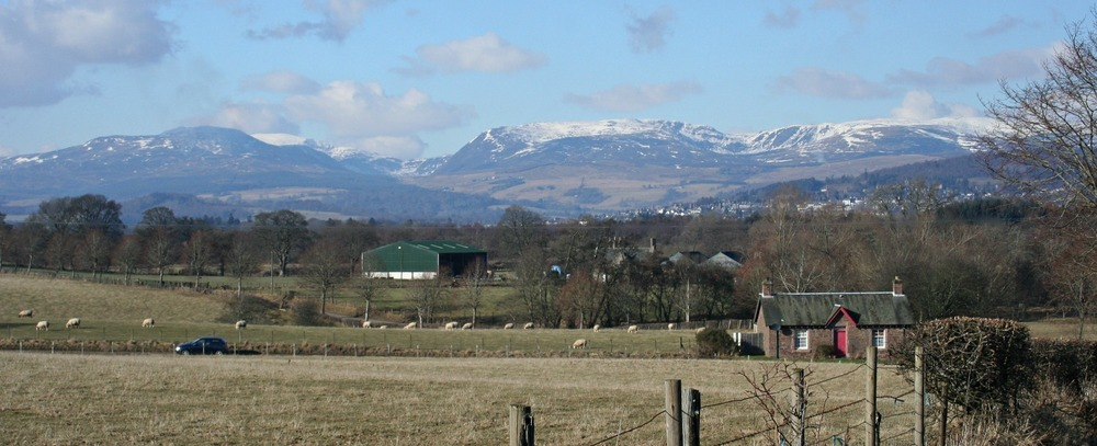 Looking north across the Highland Boundary Fault with Glen Turret and Ben Chonzie (white hilltop left-ish above green barn).