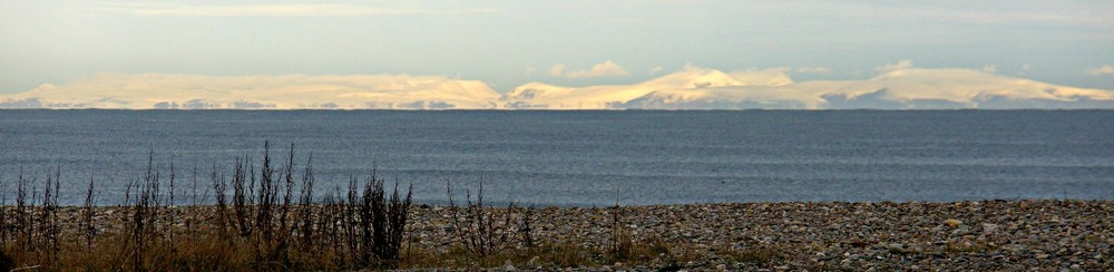 The Northern Highland hills seen from the coast of Moray in winter.