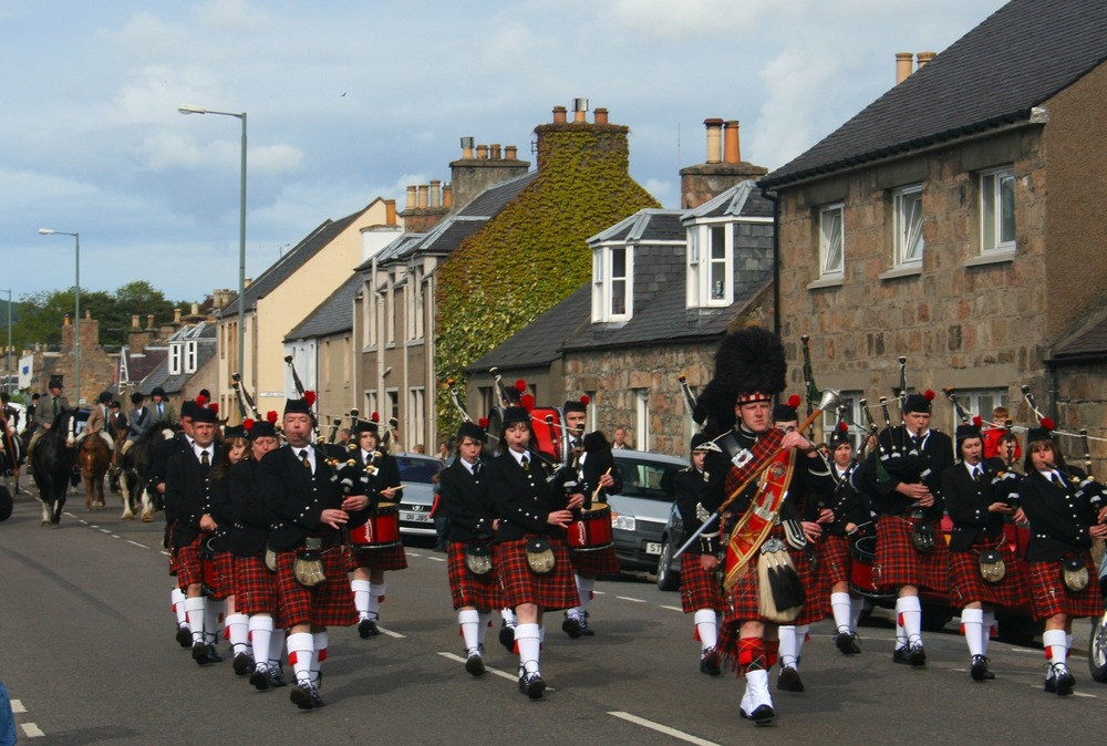 Dufftown Pipe Band march through Aberlour, Moray's shortbread capital.