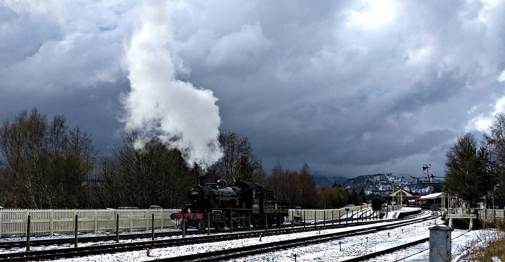 Ivatt Class 2 backs down for the first train of the day from Aviemore, after a late snowfall.