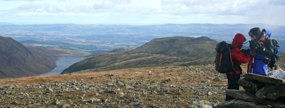 It isn't especially  late in the year, but it's late in the day and, as you can see, there's a keen wind blowing on the summit of Ben Chonzie. This view looks south over Strathearn.