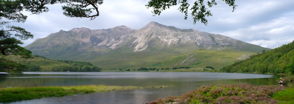 Beinn Eighe from Loch Clair. The Glen Torridon road runs along the base of the mountain, east/west beyond the loch.