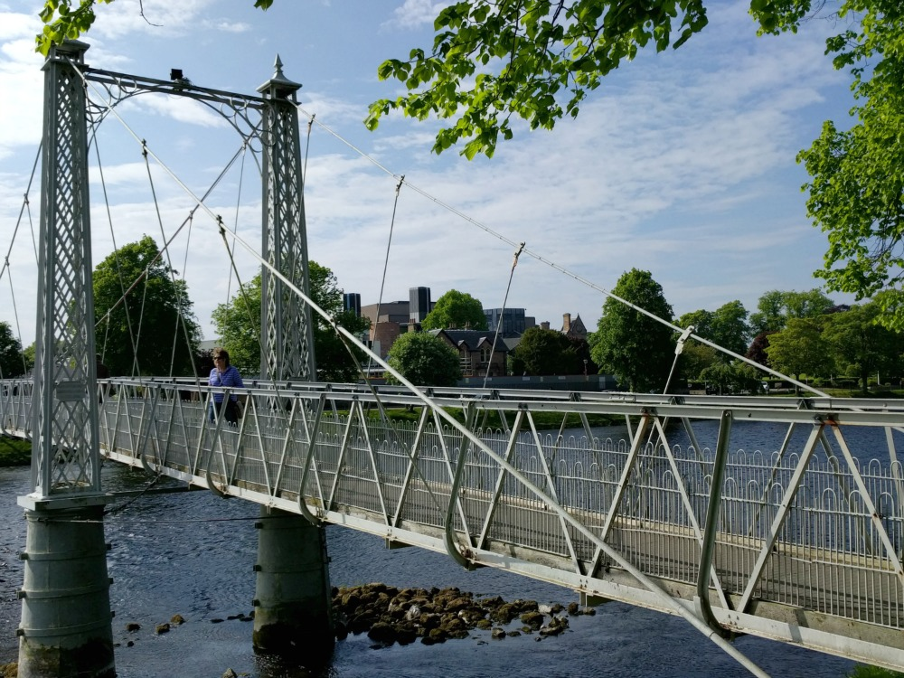 Pedestrian bridge over the River Ness in Inverness. Eden Court Theatre in background.