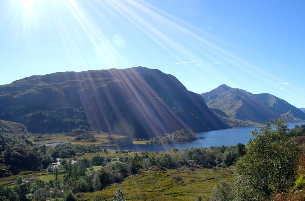Looking south, down Loch Shiel, into the sun. Glenfinnan Monument is left of centre. Note this picture was taken on the 1st day of October. Yes, as late in the year as that and the  midges that day were still horrendous .