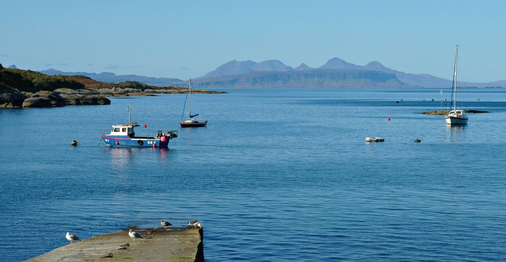 Rum Coolin and also Eigg, half-hidden left, from Glenuig.