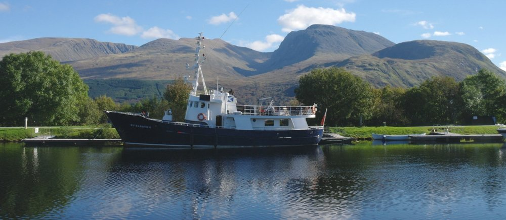 If you decide on the classic Scottish tour, then you'll pass Ben Nevis, Scotland's highest mountain, at the south end of the Great Glen. This view is looking east over the Caledonian Canal, near Fort William.