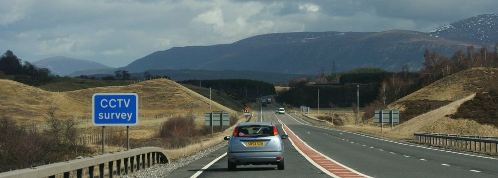 The A9 near Kingussie. Overtaking lane starting the other way (south-bound). Long(ish) single-carriageway straight looking northbound. Tempting. confusing. And stop peering at the mountains, will ya?