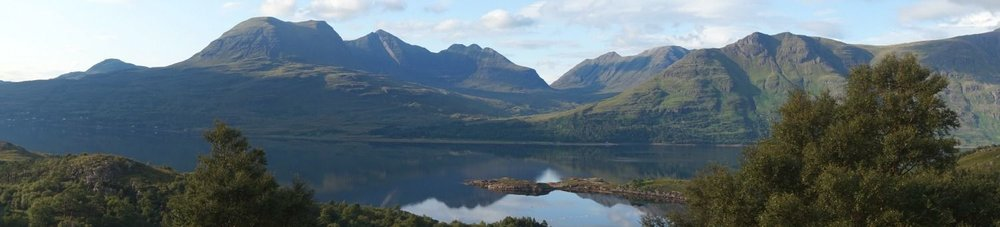 Loch Torridon panorama, with Beinn Alligin left and west end of Liathach on right.