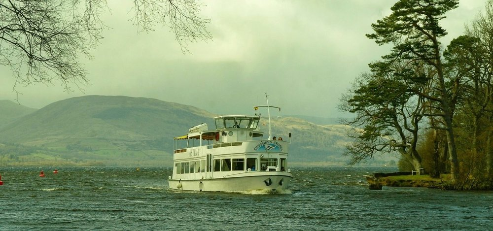 One of Sweeney's Cruises, returning to the base at Balloch on the River Leven, with Loch Lomond behind.