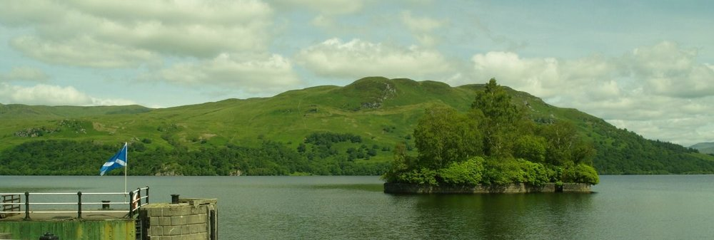 Loch Katrine, at Stronachlachar, with Factor's Island, right.