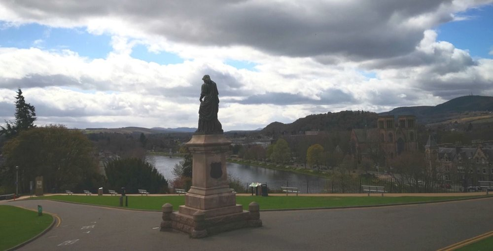 Looking south, against the light, from the site of Inverness Castle on a cold April day.  Flora MacDonald statue looks south as well, over the River Ness and down the Great Glen.